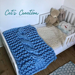 Arm Knitted Cot Blanket